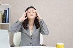 Business woman who has a headache Stock Photos