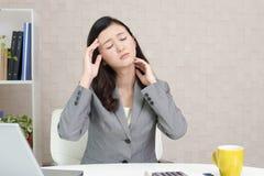 Business woman who has a headache Stock Photography