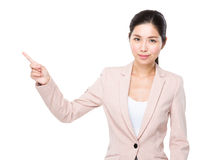 Asian business woman finger point aside Stock Images