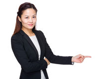 Asian business woman with finger point to indicate Royalty Free Stock Images