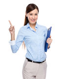 Asian business woman finger up with clip board Royalty Free Stock Photo