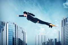 Asian business woman flying with rocket shoes. Business challenge concept Stock Photos