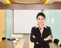 Asian business woman with folded hand smiling Royalty Free Stock Photos