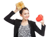 Asian business woman with gift box and red heart. Isolated on white background Royalty Free Stock Photos