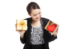 Asian business woman with gift box and red heart. Isolated on white background Stock Image