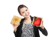 Asian business woman with gift box and red heart. Isolated on white background Royalty Free Stock Images
