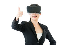 Asian business woman good like to use VR headset glasses Royalty Free Stock Photos