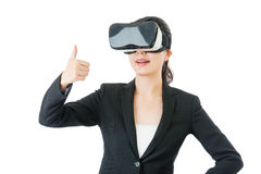Asian business woman good like to use VR headset glasses Stock Photos
