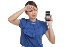 Asian business woman got  headache with calculator Royalty Free Stock Image