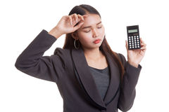 Asian business woman got  headache with calculator. Royalty Free Stock Photography