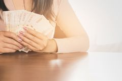 Asian business woman hand  holding money planing to invest or paying Royalty Free Stock Photos