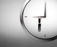 Asian business woman hanging on the clock Stock Photography