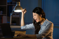 Asian business woman happy got success idea working overtime Stock Image