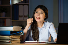 Asian business woman happy idea working overtime late night Stock Photography
