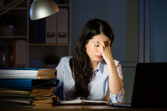 Asian business woman headache overtime working late night Stock Photo