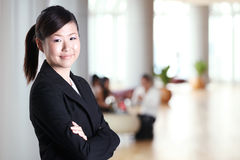 Asian business woman with her arms crossed Stock Photo