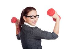Asian business woman hold dumbbells turn back and smile Royalty Free Stock Images