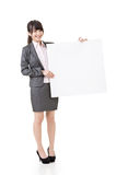 Asian business woman hold empty blank board Stock Photo