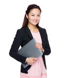 Asian business woman hold with laptop computer Stock Images