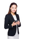 Asian business woman hold with mobile phone Royalty Free Stock Photography