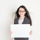 Asian business woman holding a blank placard Stock Photography