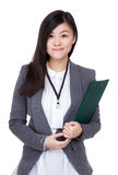 Asian business woman holding clipboard Royalty Free Stock Images