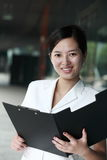 Asian business woman holding with folder Stock Images