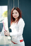 Asian business woman holding with folder Stock Photography
