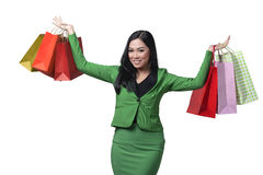 Asian business woman holding many shopping bag Stock Photo