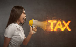Asian business woman holding megaphone with TAX  announcement Stock Photography