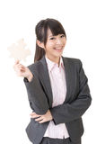 Asian business woman holding a piece of puzzle Stock Photo