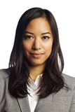 Asian business woman holding sign. Closeup portrait of a confident asian business woman with folded arms over white background Stock Images