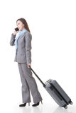 Asian business woman holding a suitcase Stock Photo