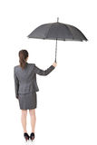 Asian business woman is holding umbrella Stock Photography