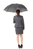 Asian business woman is holding umbrella Royalty Free Stock Photos