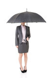 Asian business woman is holding umbrella. Stock Photo