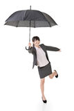 Asian business woman holding umbrella. Stock Images