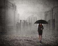 Asian business woman holding umbrella Stock Photos