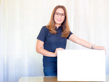 Asian business Woman holding White board in office. Royalty Free Stock Photo