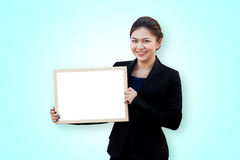 Asian business woman holding white board Stock Photography
