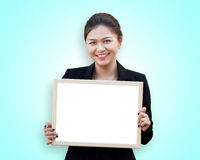 Asian business woman holding white board Stock Photo
