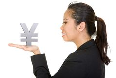 Asian business woman holding a yen Stock Photo