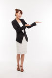 Asian business woman indicate blank space. Royalty Free Stock Photos