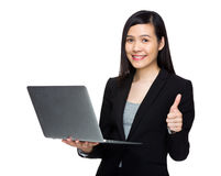 Asian business woman with laptop computer and thumb up Stock Photo