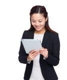Asian business woman look at digital tablet Royalty Free Stock Photos