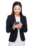 Asian business woman look at mobile phone Stock Image