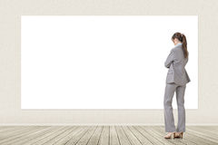 Asian business woman looking at blank banner Stock Images
