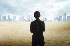 Asian business woman looking the city on the desert Stock Photos