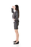 Asian business woman looking far away Royalty Free Stock Photo