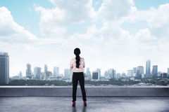 Asian business woman looking to the city Stock Photos